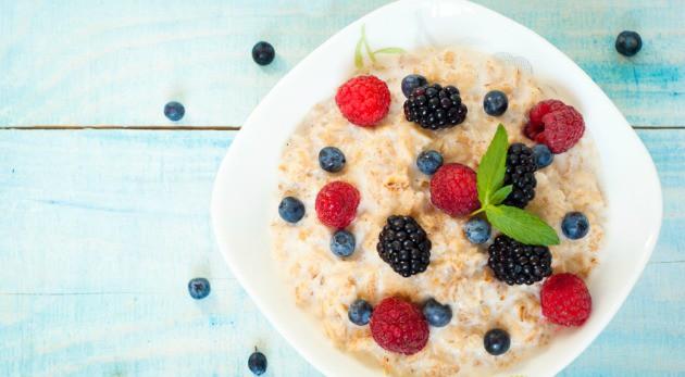 Healthy breakfast - oatmeal with blackberries, blueberries and raspberries